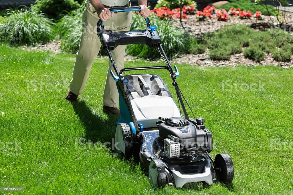 Modern lawn mower stock photo