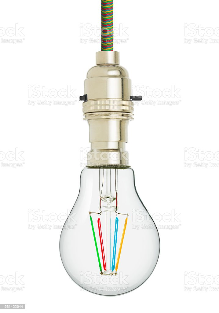 Modern LED filament light bulb hanging from multi coloured cord stock photo