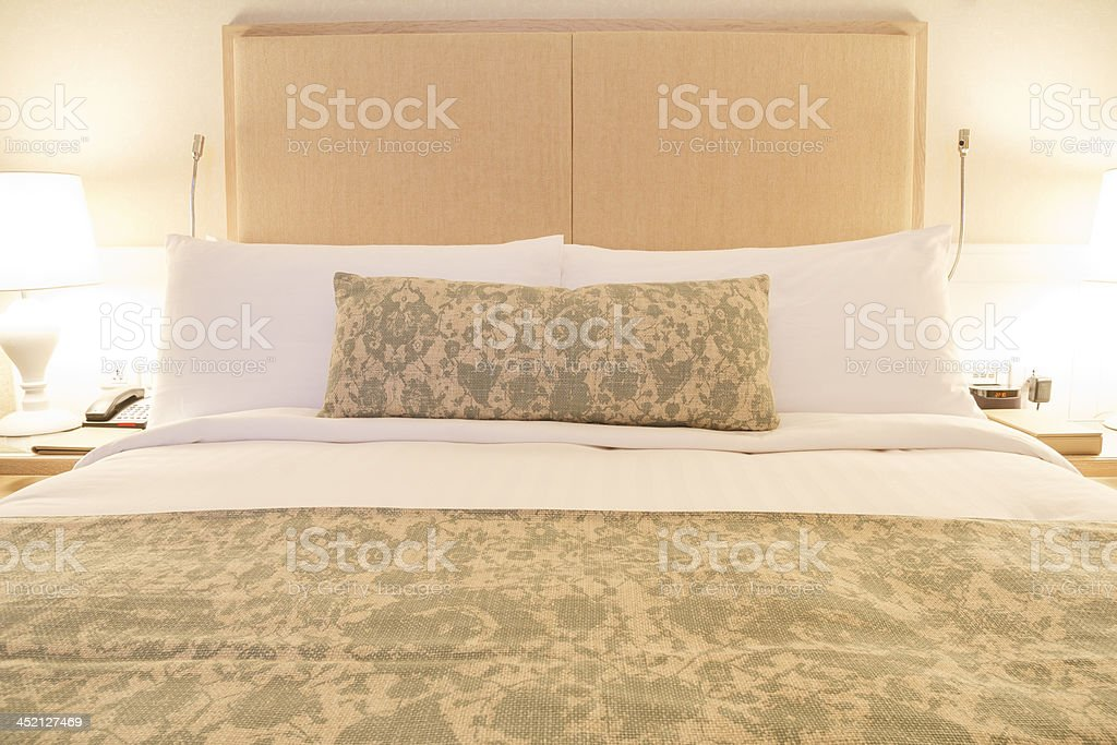 Luxuary wood headboard with modern and cozy linen bedding