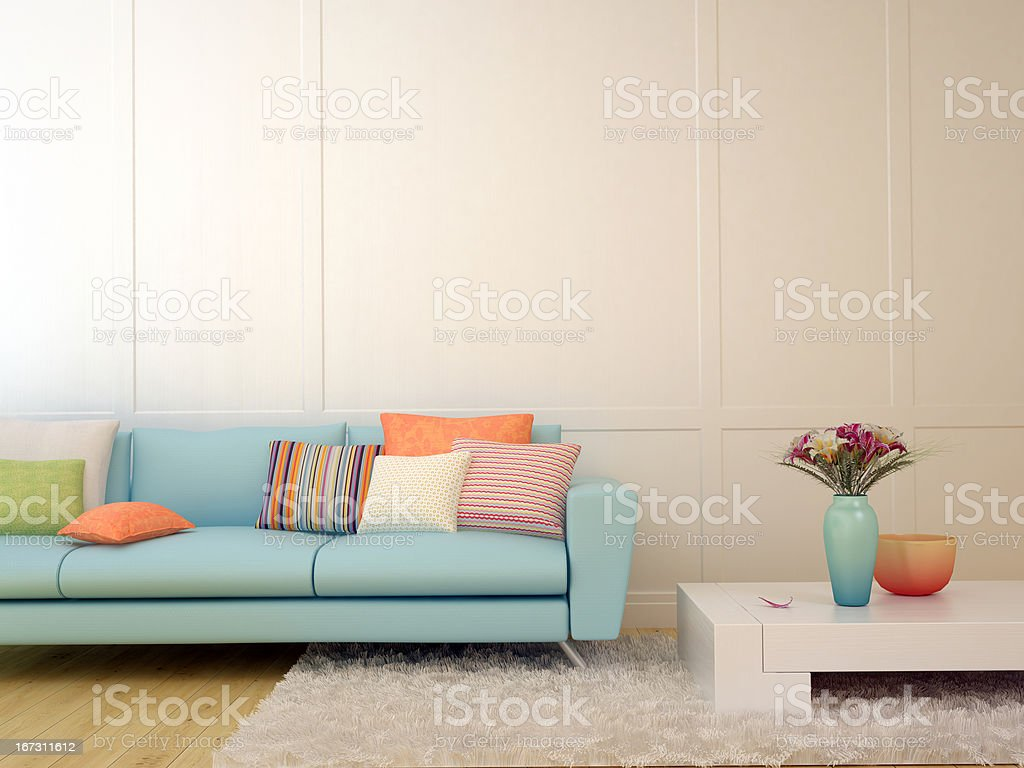 Blue sofa with colorful pillows and a white coffee table stock photo