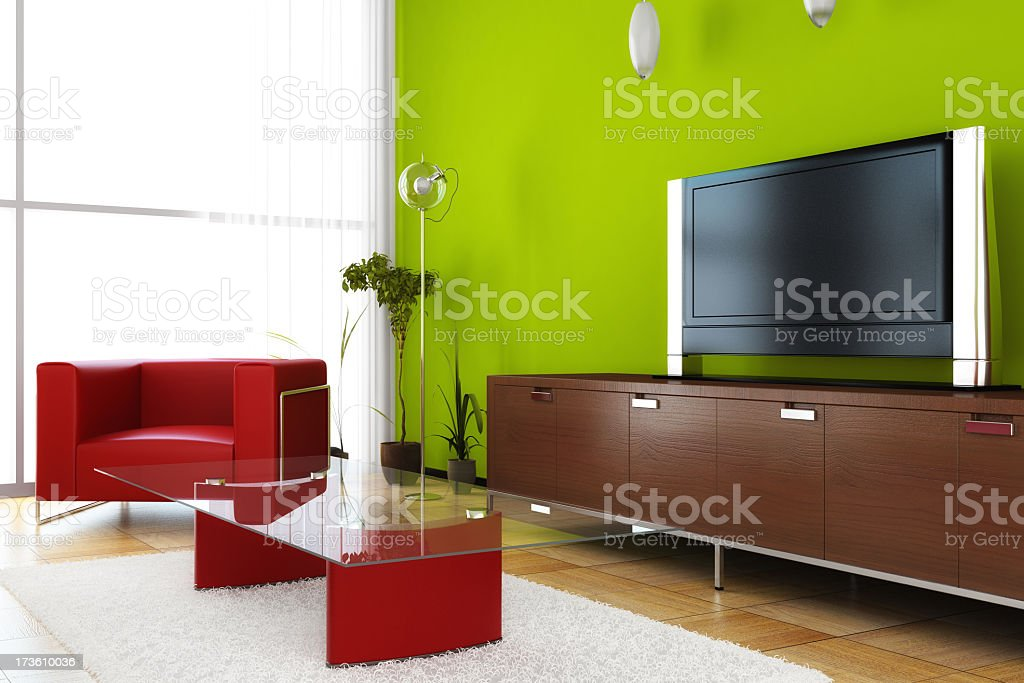 A modern living room design with red sofa and glass tabletop royalty-free stock photo