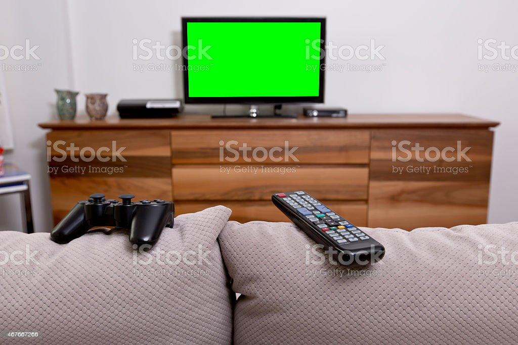 Modern living room with 42 inch TV and accessories stock photo
