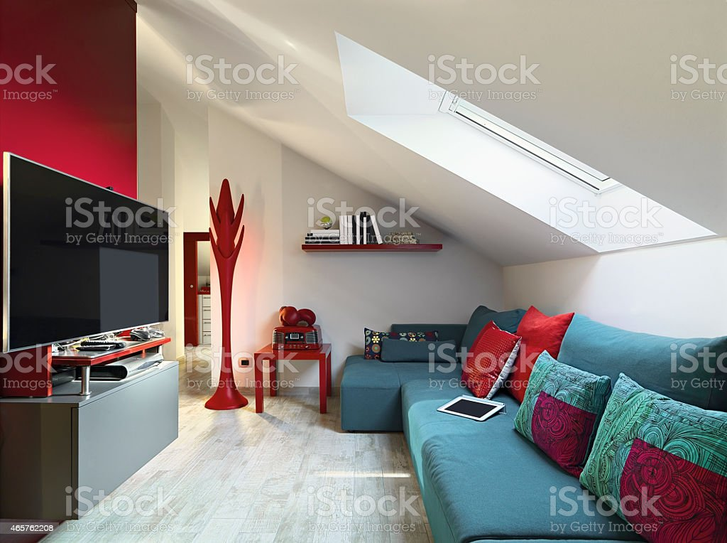 Modern living room with a slanted ceiling stock photo