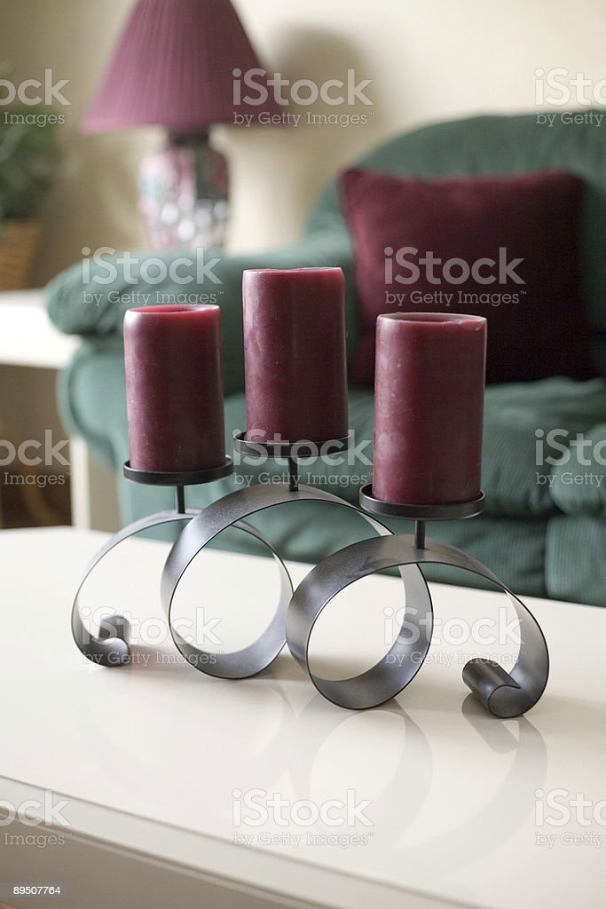Modern living room with candles. royalty-free stock photo
