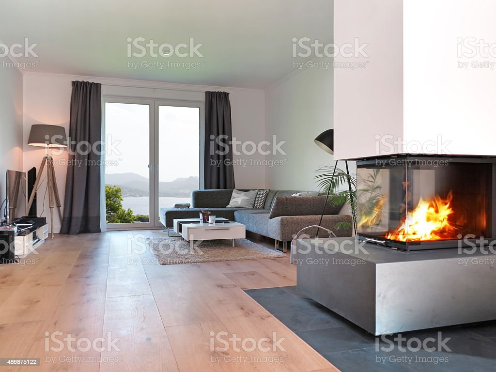 modern living room with fire place stock photo