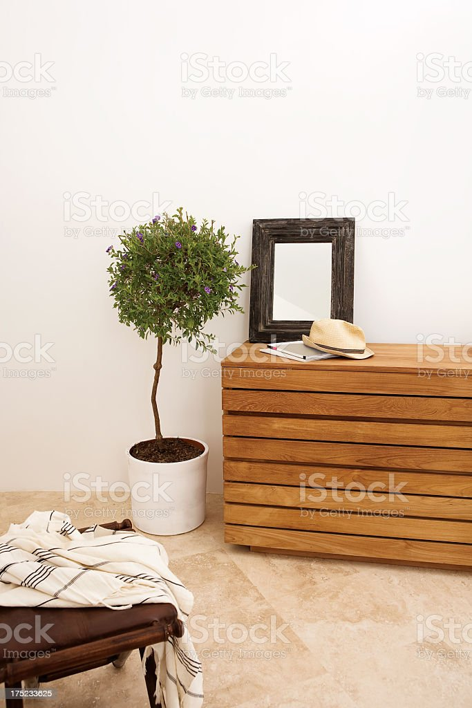 Modern living room with plant, photo frame and folded table royalty-free stock photo