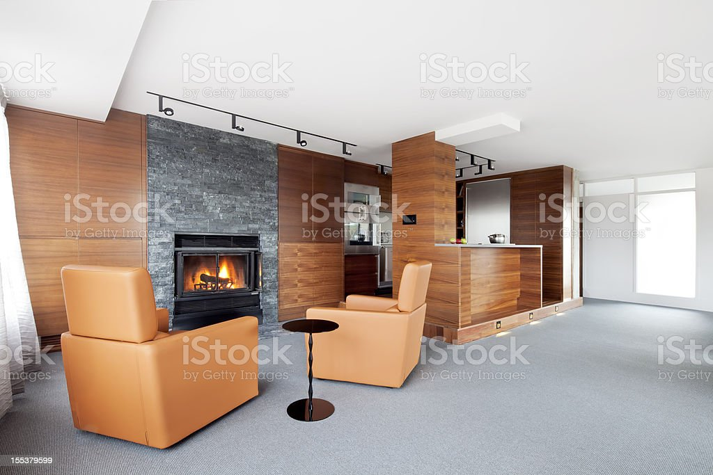 Modern Living Room with roaring fire stock photo