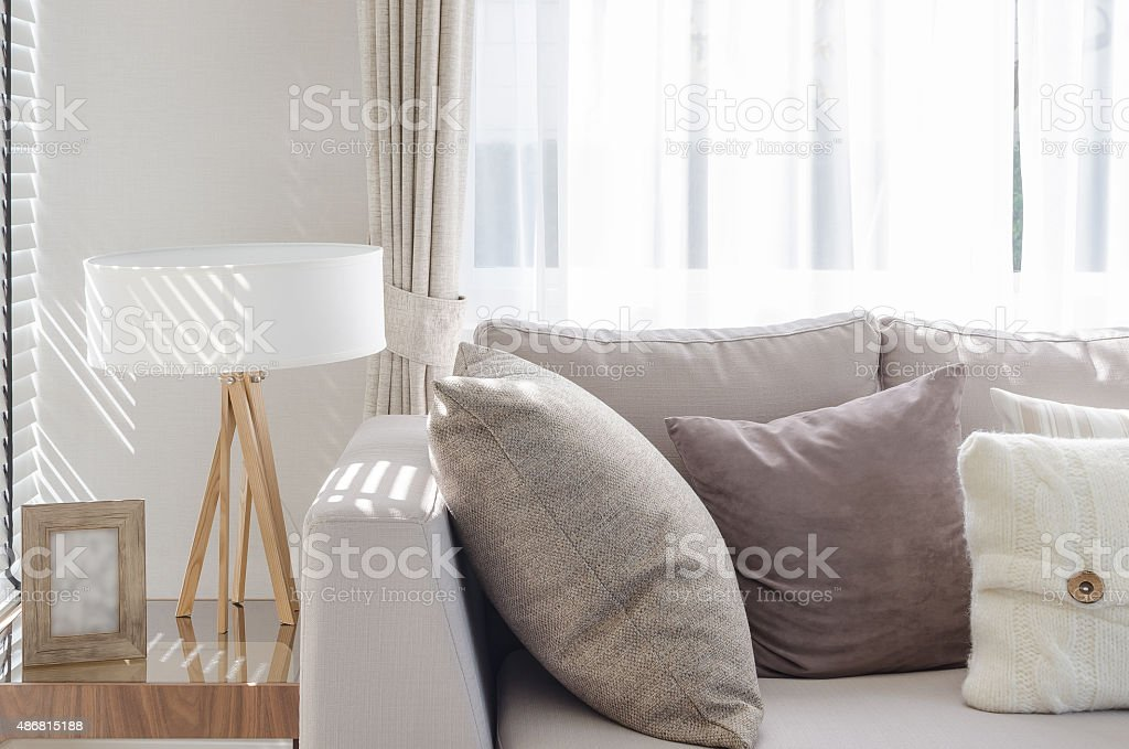 modern living room with sofa and wooden lamp stock photo