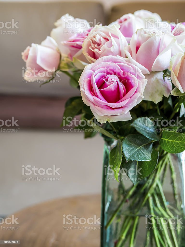 Modern Living room with vase of pink roses stock photo