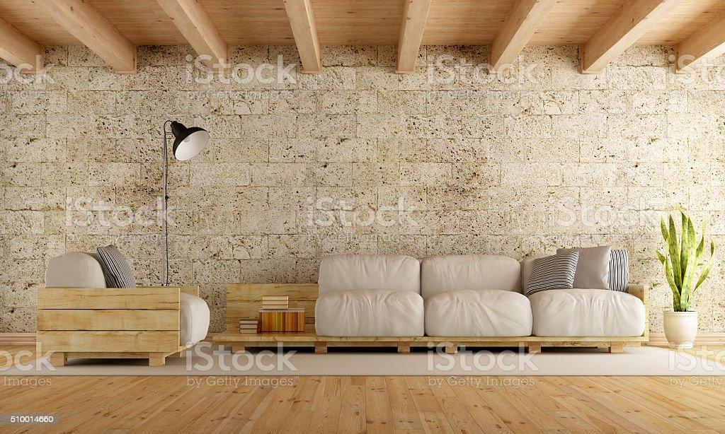 Modern living room wth pallet sofa stock photo