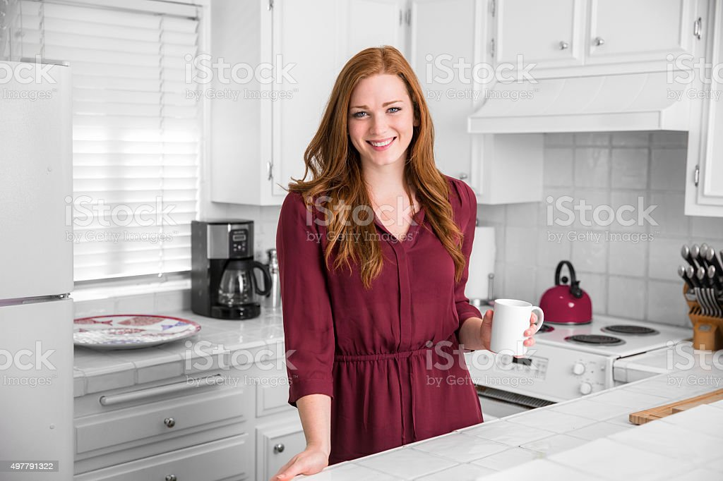Modern living woman coffee tea cup kitchen red burgundy wife stock photo