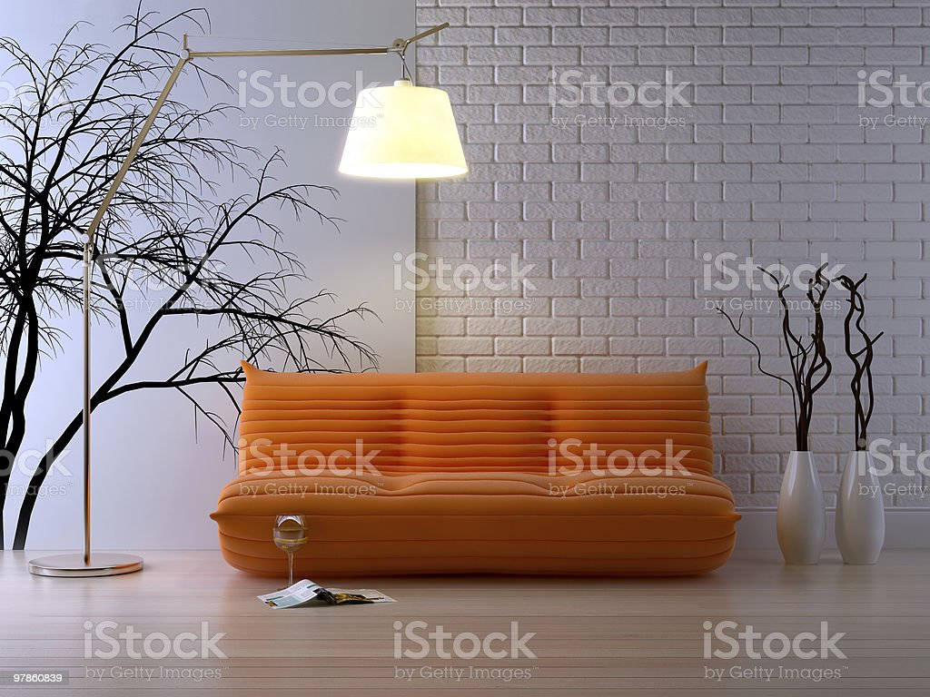 Modern loft interior featuring an orange couch and big lamp royalty-free stock photo