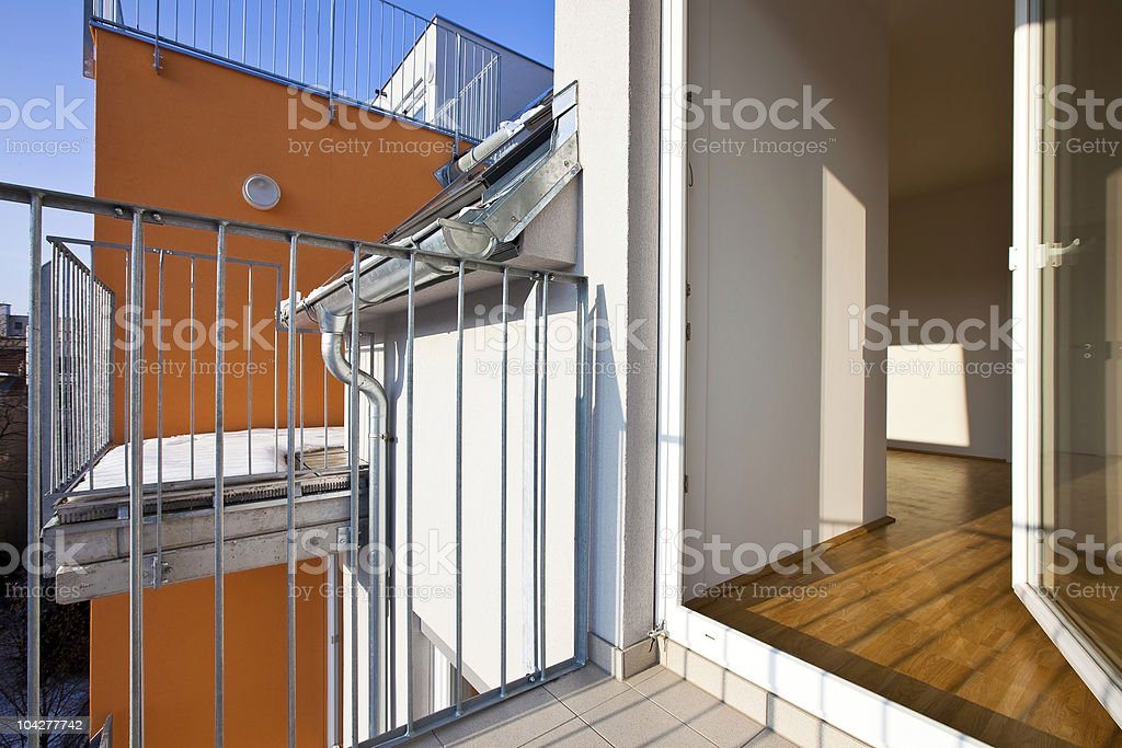 Modern loft with opened terrace door royalty-free stock photo