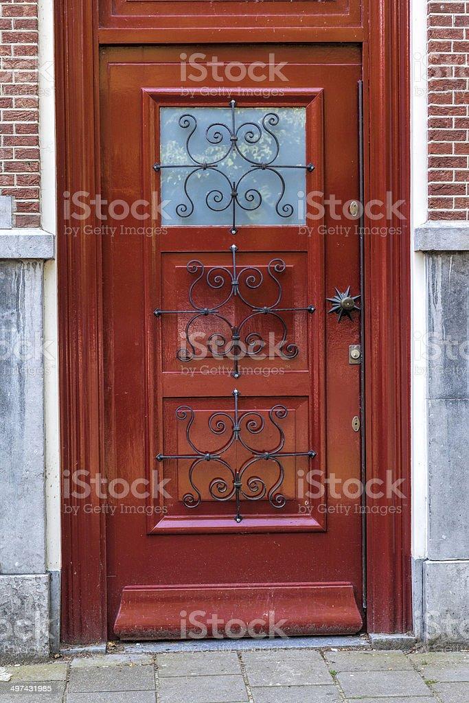 Modern looking brown wooden door stock photo
