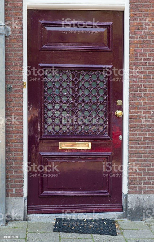 Modern looking purple wooden door stock photo