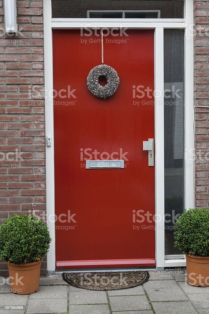 Modern looking red wooden door stock photo