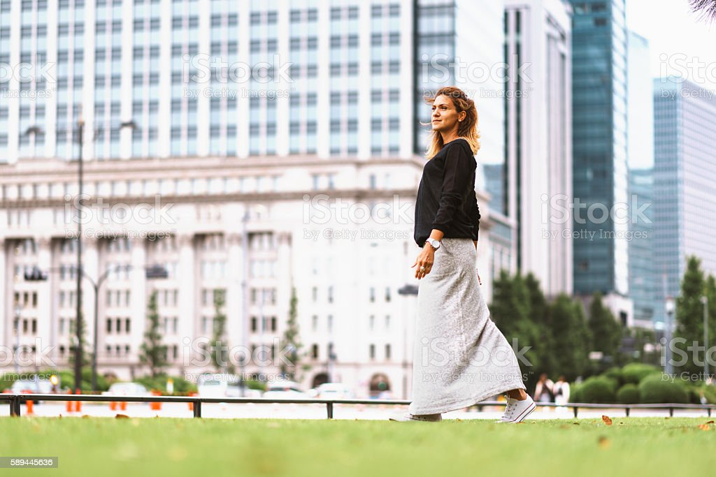 Modern looking woman in street fashion clothing in Tokyo stock photo
