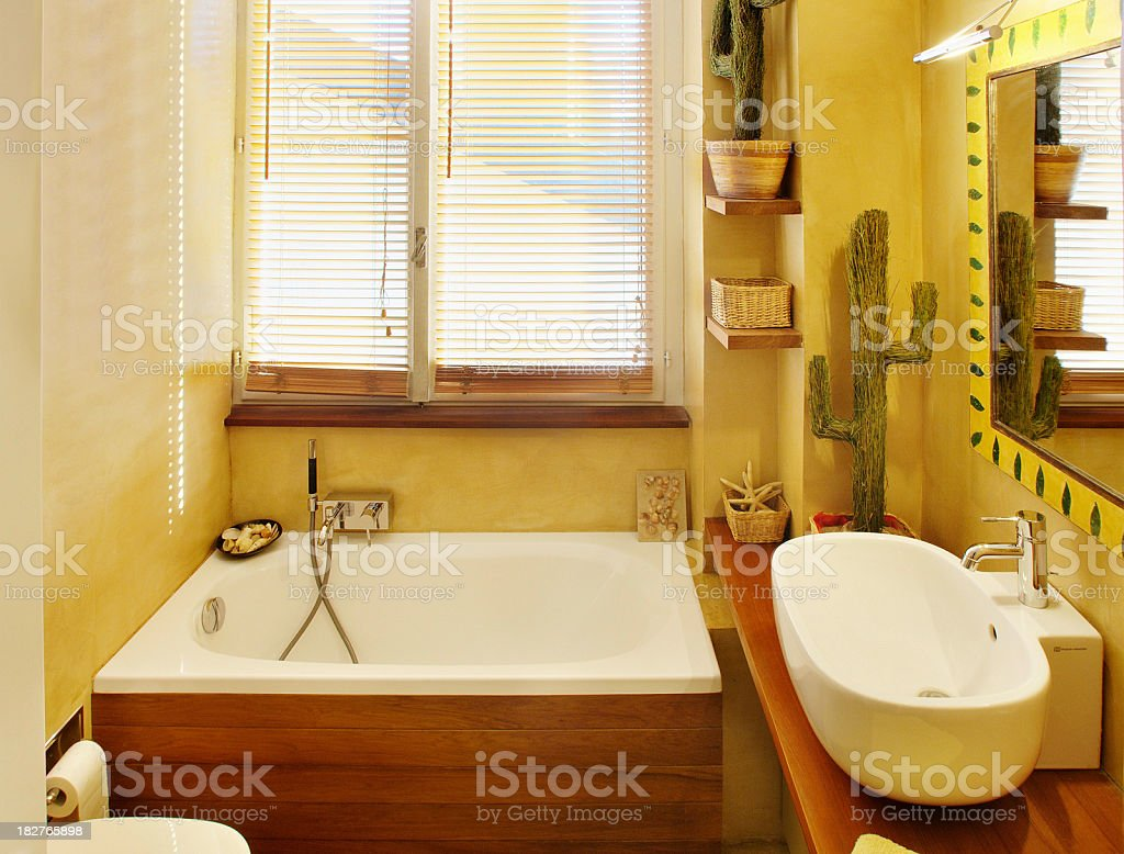 Modern luminous and warm bathroom, with small wooden bathtub royalty-free stock photo