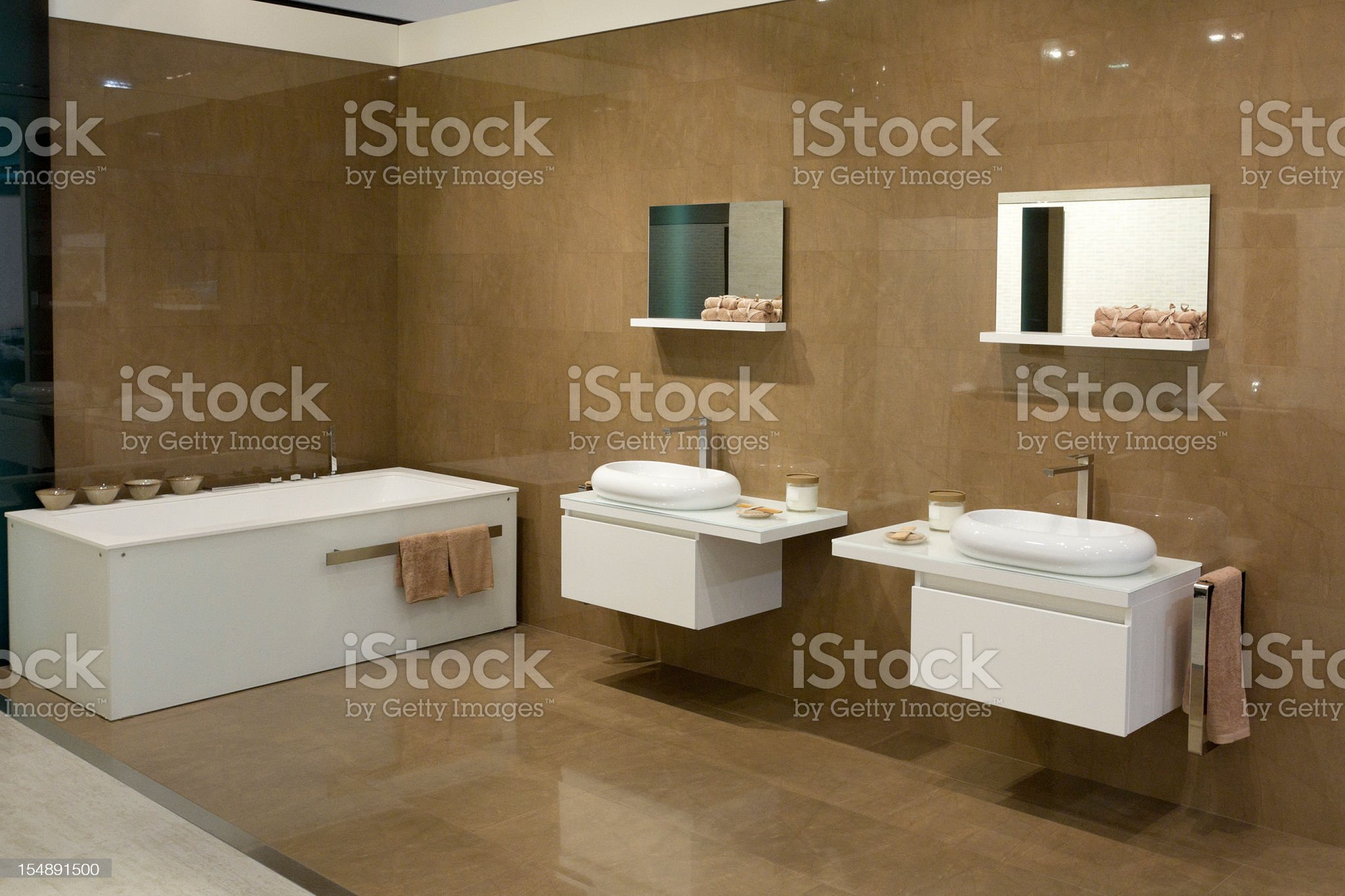A modern luxurious bathroom with square sinks and bathtub  royalty-free stock photo