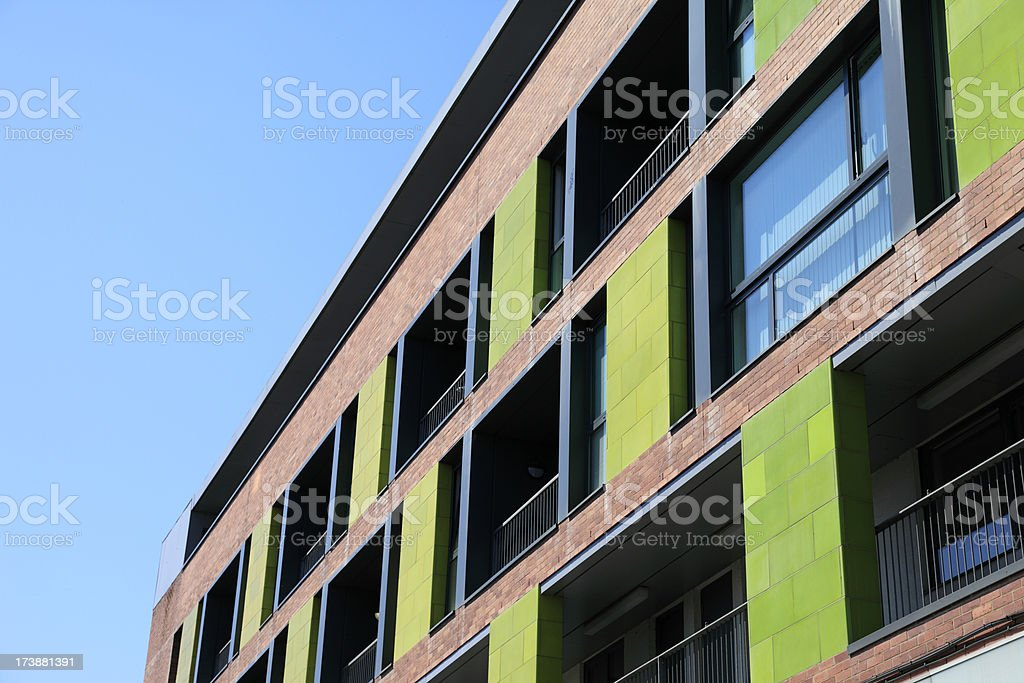 Modern luxury apartments exterior, showing windows and balconies royalty-free stock photo