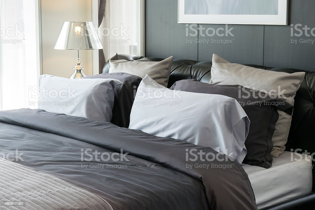 modern luxury bedroom with pillows and lamp stock photo