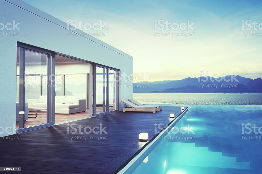 Minimalist modern villa exterior with infinity pool and beautiful...