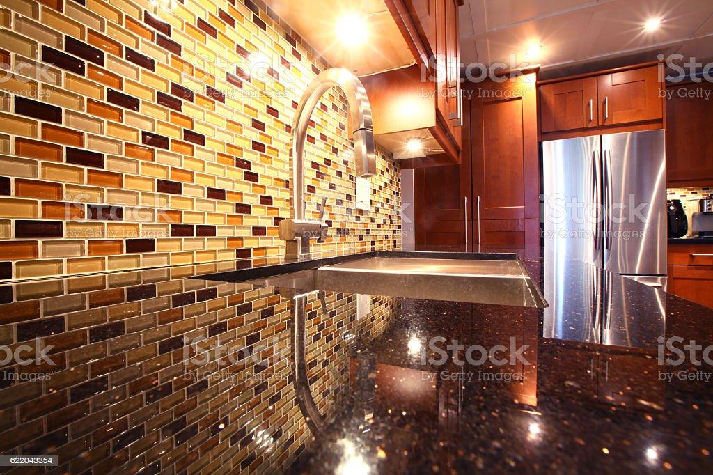 Modern luxury kitchen with mosaic backsplash and granite stock photo