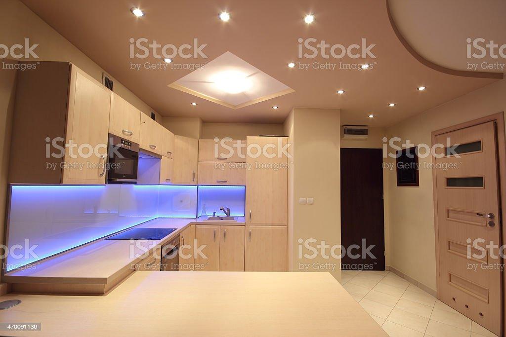 Modern luxury kitchen with purple LED lighting stock photo