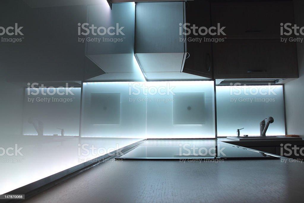 modern luxury kitchen with white led lighting stock photo