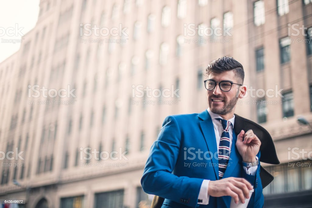 Modern man holding coffee cup stock photo