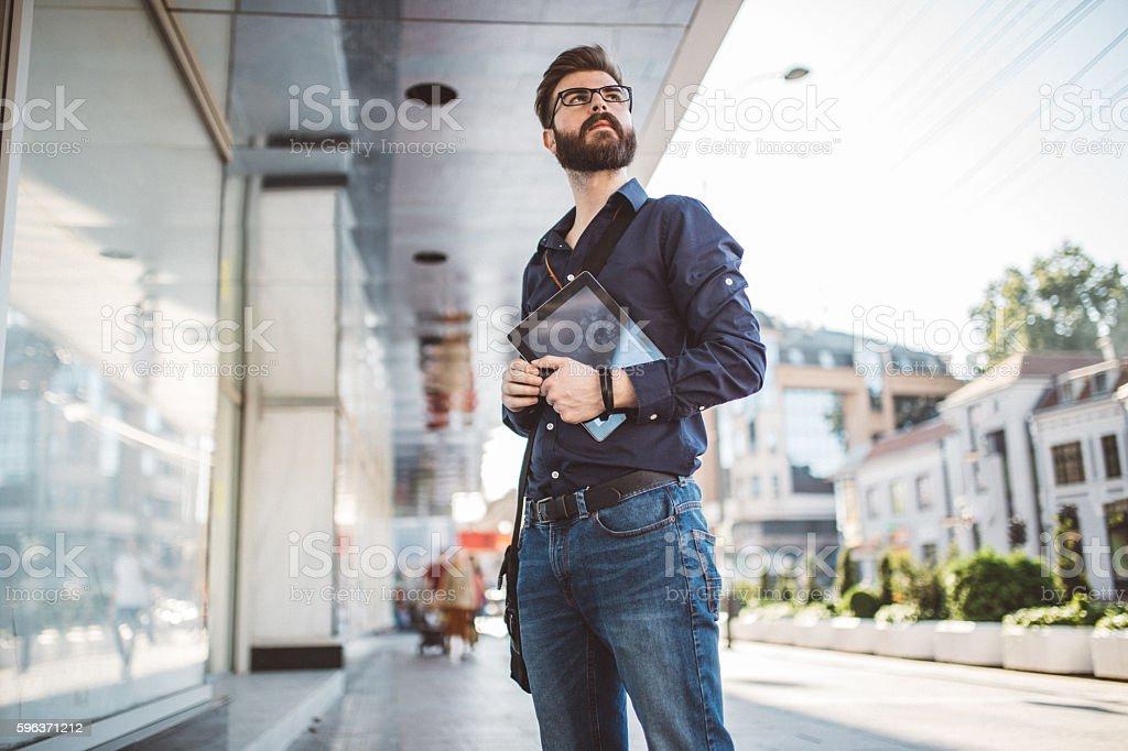 Modern man holding tablet stock photo