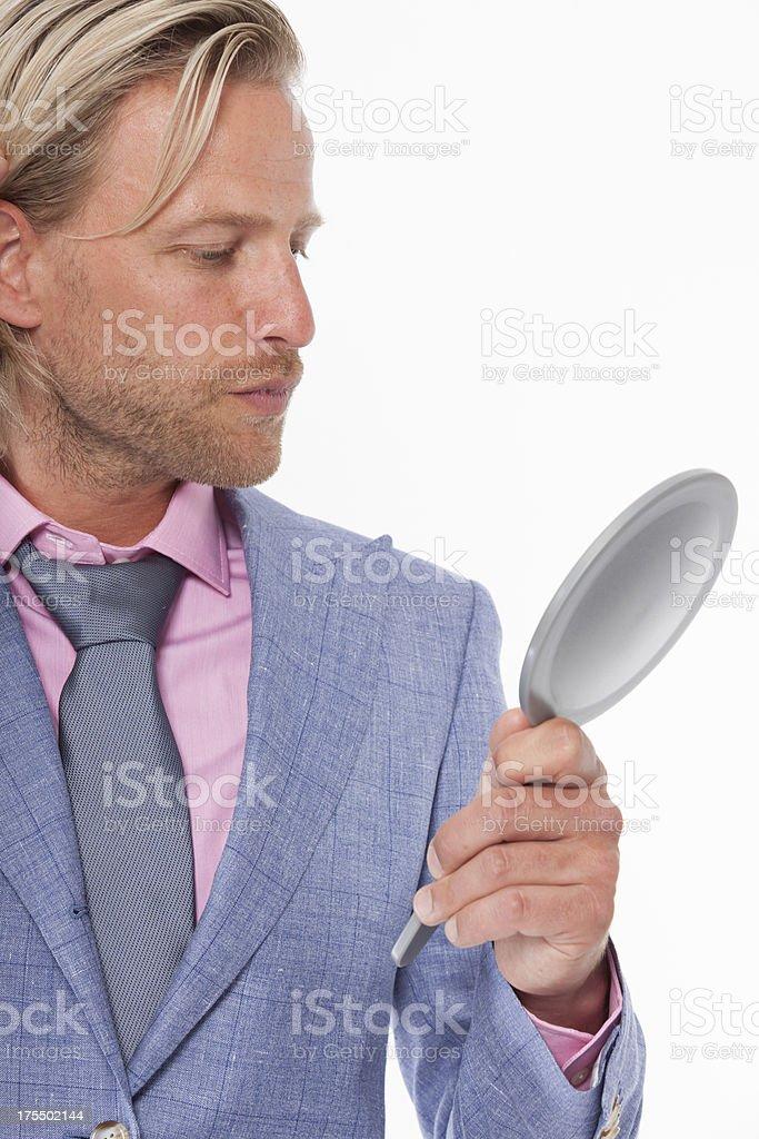 Modern man inspecting his skin stock photo