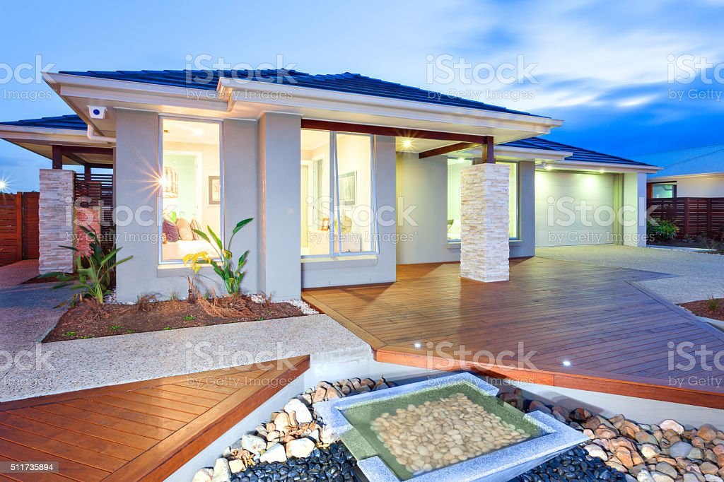 Modern mansion with wooden floorboards stock photo