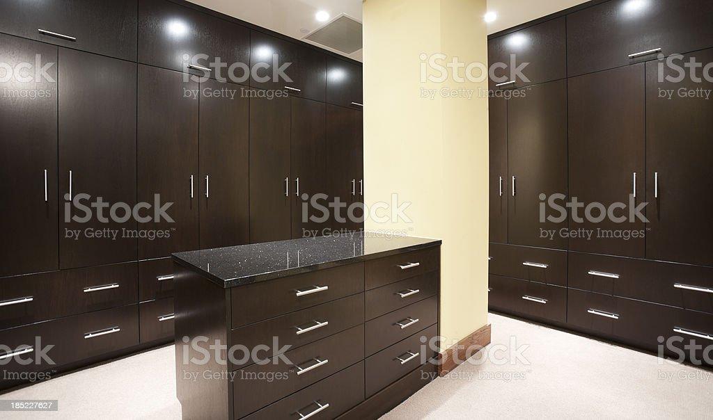 Modern master bedroom closet with dark stain. stock photo