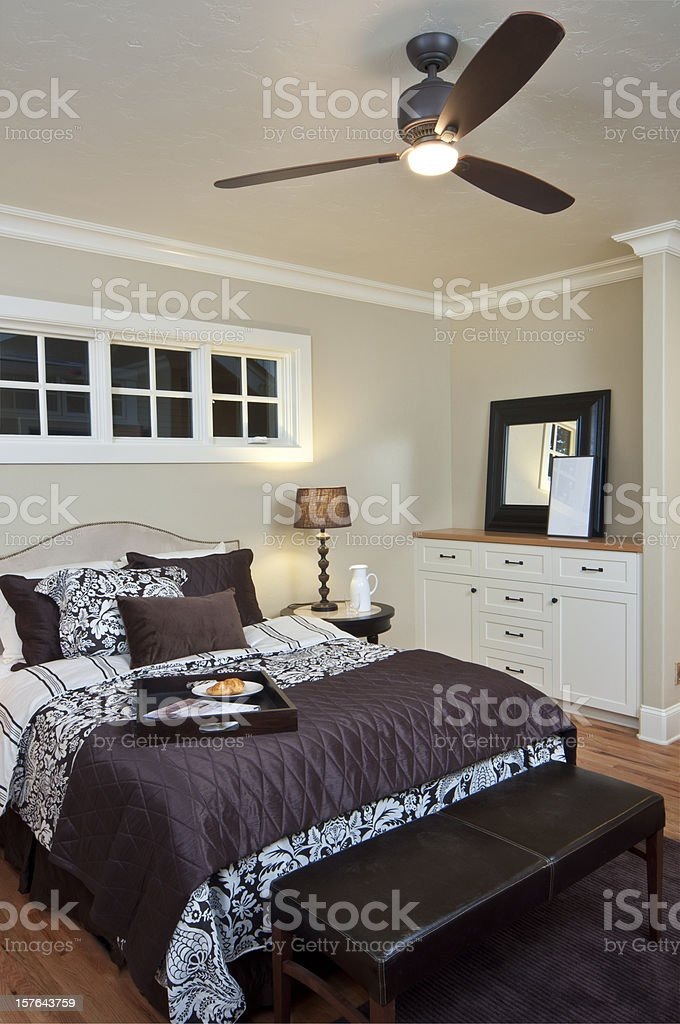 Modern master bedroom with dresser royalty-free stock photo