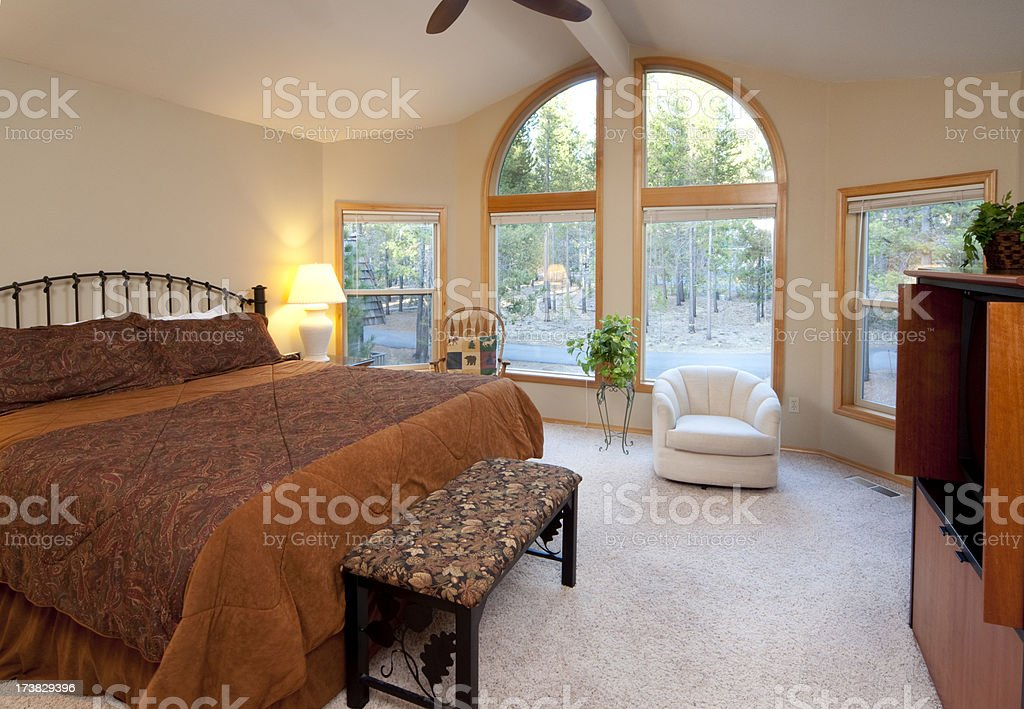 Modern master room with high arch window stock photo