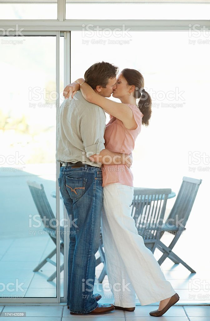 Modern mature couple kissing on the porch stock photo