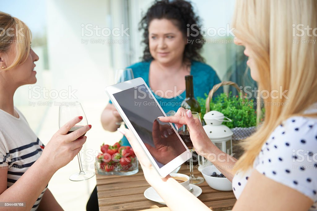 Modern mature friends at the patio stock photo