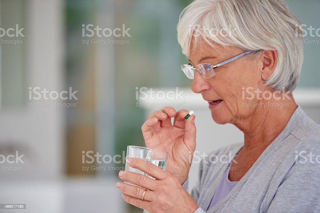 Modern medicine for senior needs stock photo