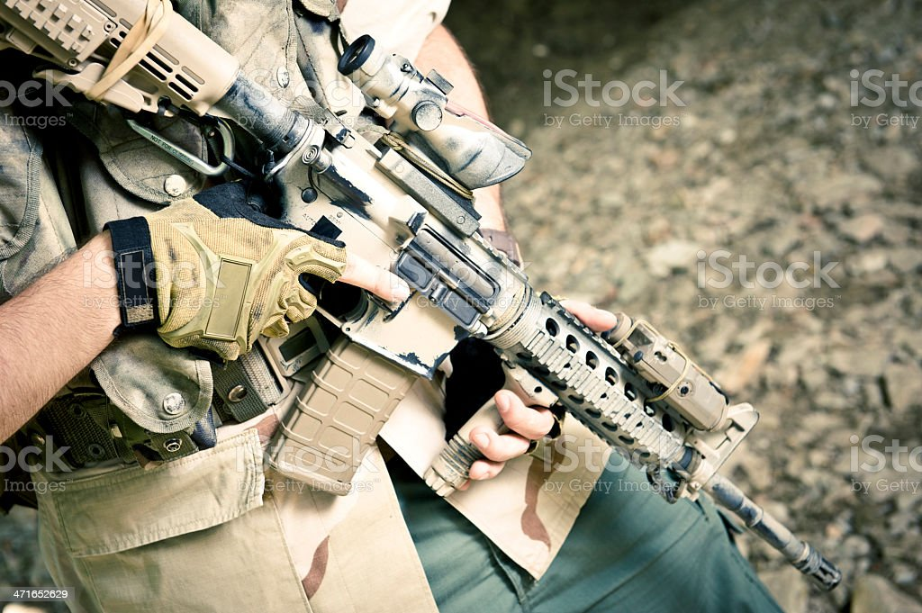 Modern Mercenary Soldier Carrying Automatic Assault Rifle stock photo