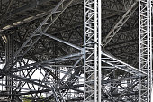 Modern metal structure of columns and trusses.