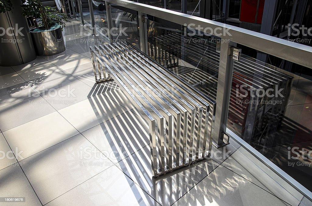 Modern metallic bench at the mall stock photo