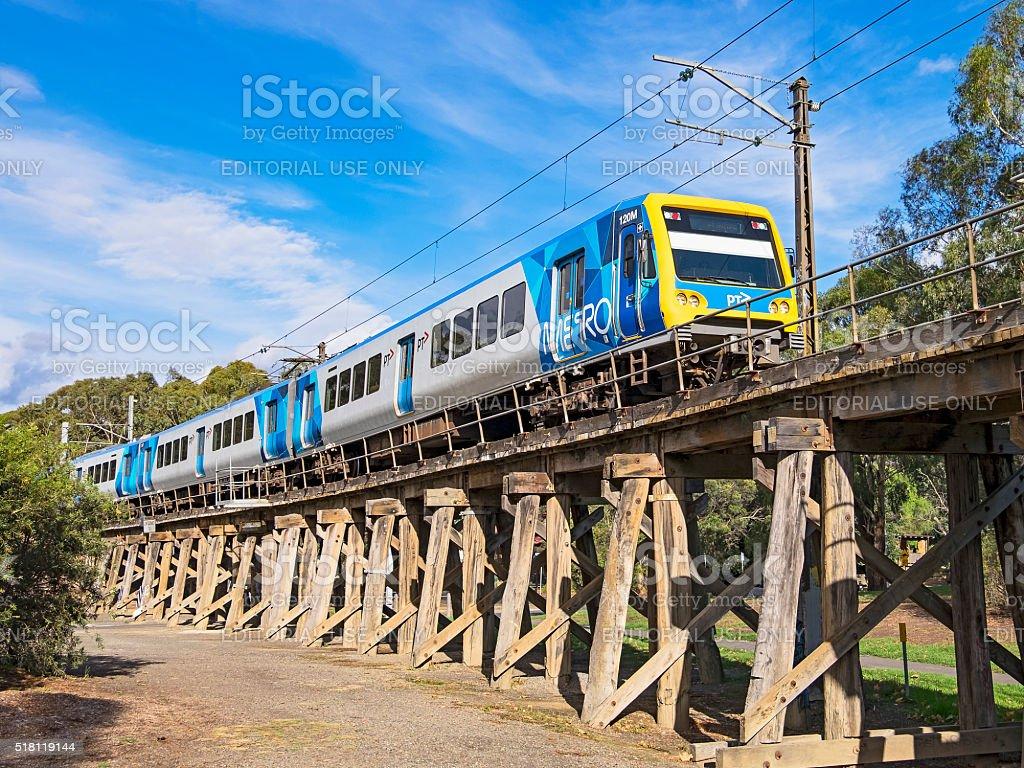Modern Metro train on old wooden Eltham viaduct stock photo