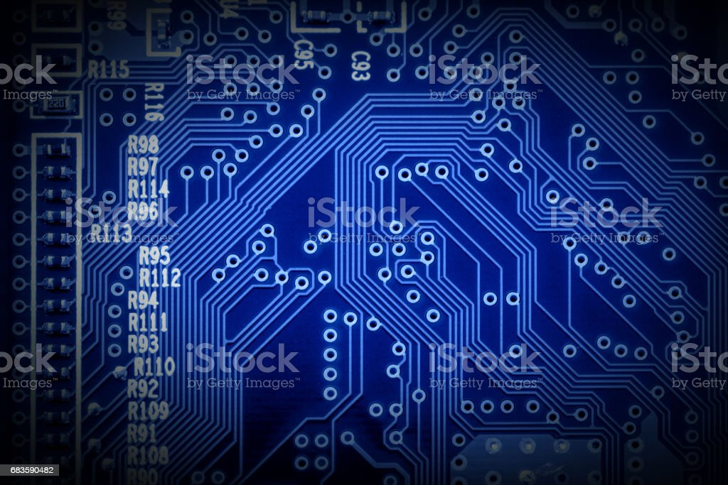 Modern microchip technology background of a printed circuit board, or PCB stock photo