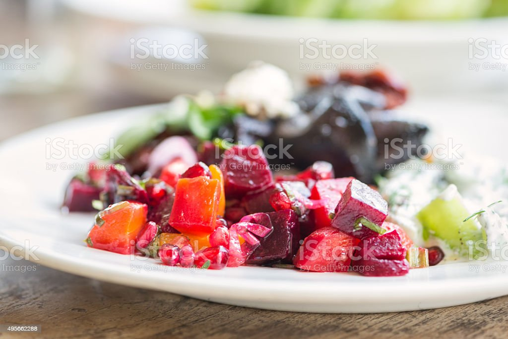 Modern Middle Eastern Salad Selection on Wood Table, Dubai, UAE stock photo