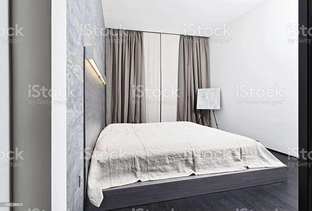 Modern minimalism style bedroom interior in monochrome tones royalty-free stock photo