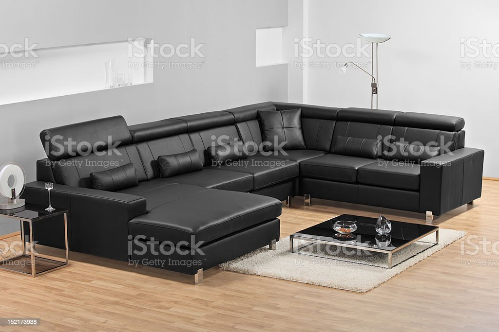 Modern minimalist living-room with leather furniture royalty-free stock photo
