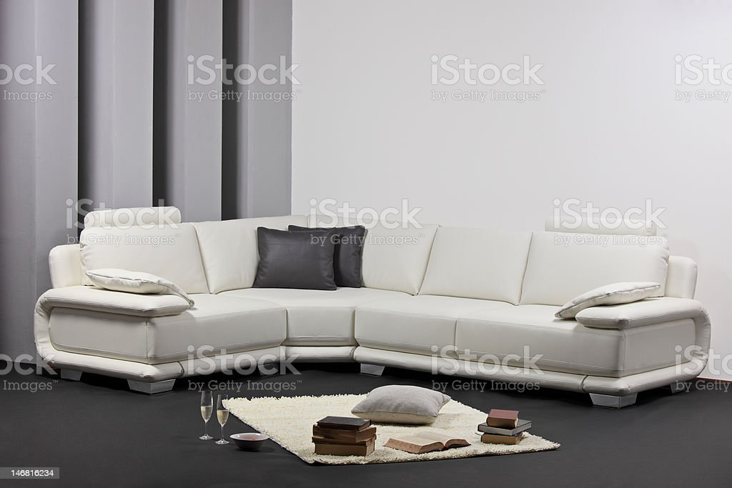 Modern minimalist living-room with white furniture royalty-free stock photo