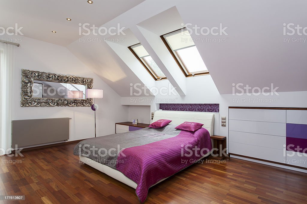 Modern minimalistic bedroom in the attic stock photo