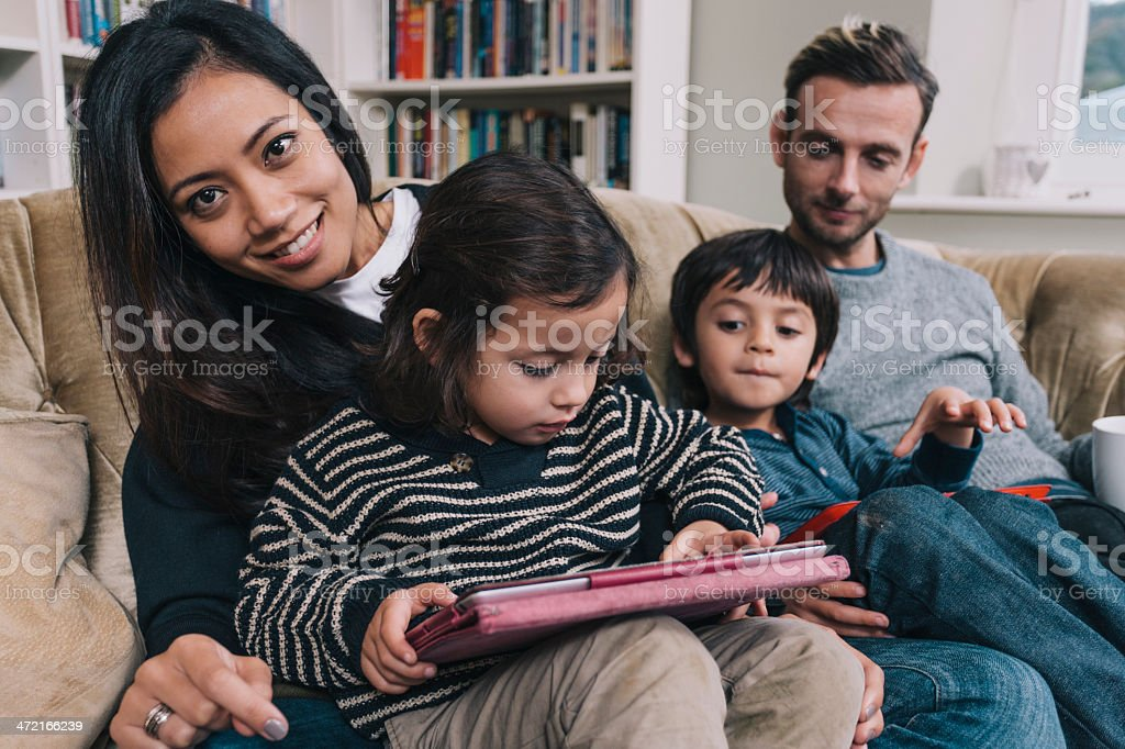 Modern mixed race young family stock photo